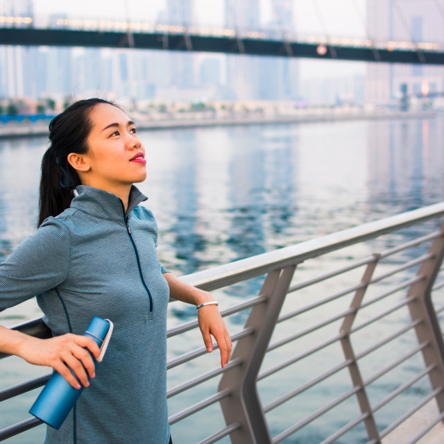 """""""Tired runner after workout by the water"""" stock image"""