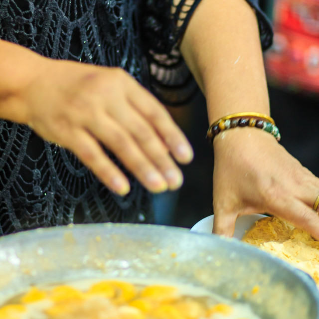 """""""Close up hands of street vendor during cooking for """"Kanom Khai Pla"""", Rice..."""" stock image"""