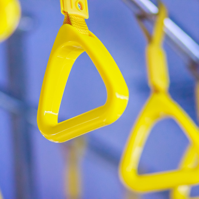 """""""Yellow handles on ceiling rails for standing passenger. Handle on the MRT,..."""" stock image"""