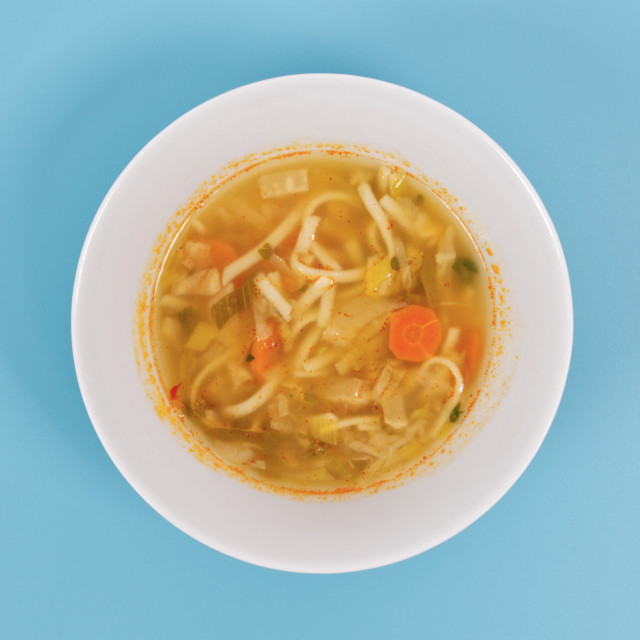 """""""Noodle soup with vegetables on a white"""" stock image"""