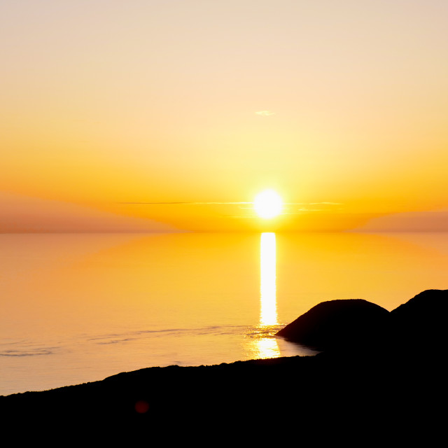 """Sunset from Pwll Deri, Pembrokeshire."" stock image"