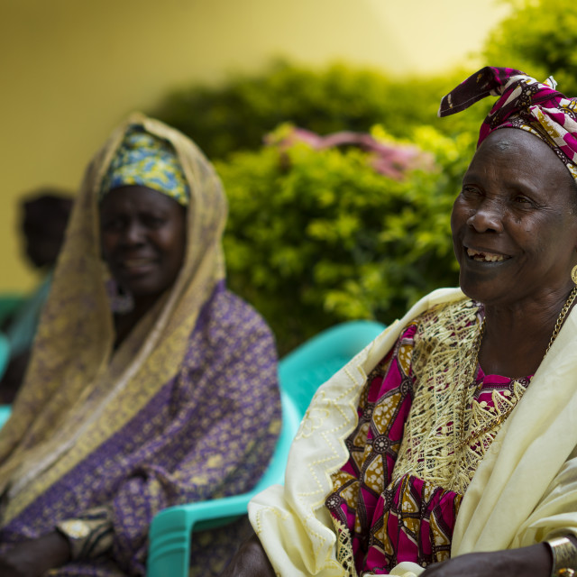 """Bissau, Republic of Guinea-Bissau - January 31, 2018: Portrait of a smiling woman at a community meeting in the city of Bissau, Guinea-Bissau, West Africa"" stock image"
