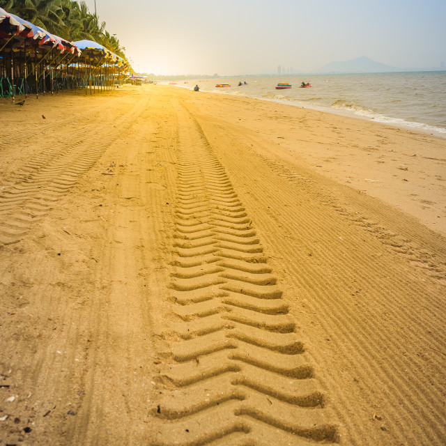 """Wheel tracks on the sandy beach in the morning at Bangsaen beach, Chonburi..."" stock image"