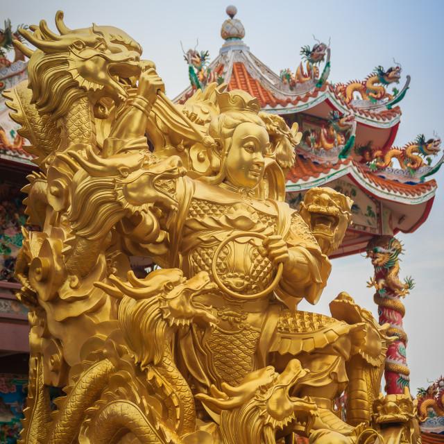 """Beautiful golden Nezha statue at Wihan Thep Sathit Phra Kitti Chaloem, the..."" stock image"