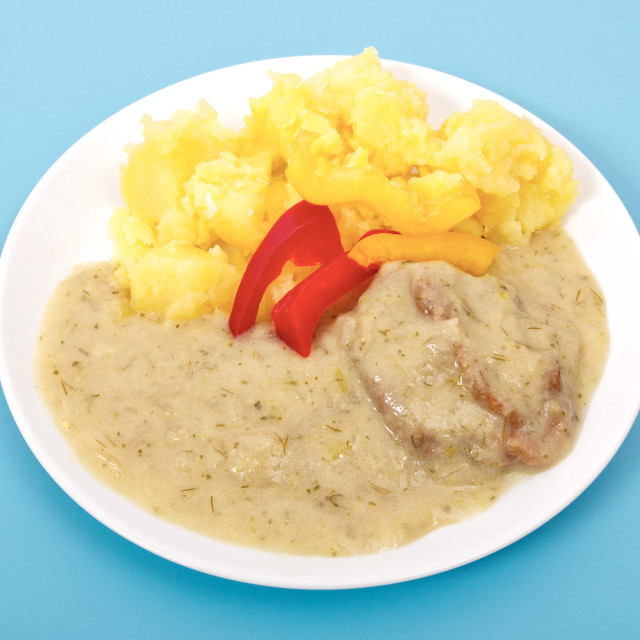 """""""Seitan with dill sauce and potatoes on a blue"""" stock image"""
