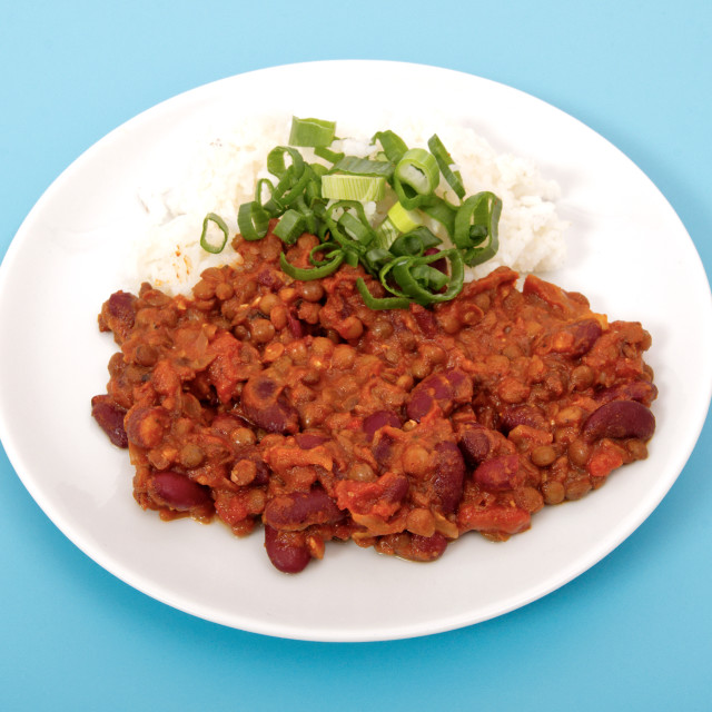 """""""Indian legume hash with rice on a blue"""" stock image"""