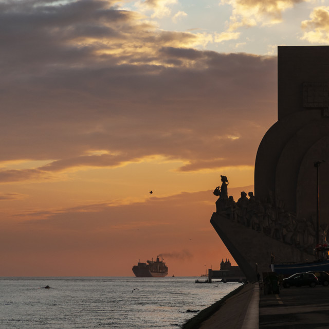 """View of the Tagus River and the Monument to the Discoveries in the city of Lisbon, Portugal, at sunset."" stock image"