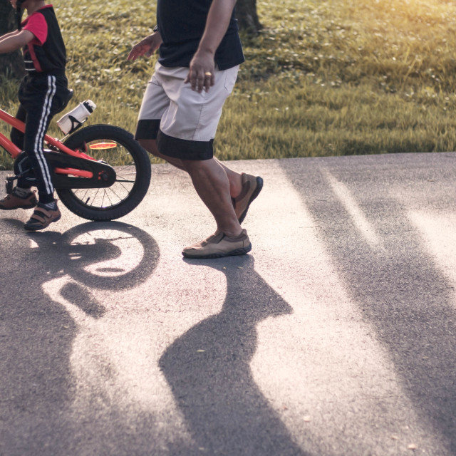 """""""Father and son are cycling."""" stock image"""