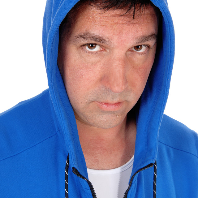 """Portrait of man in blue hoody"" stock image"