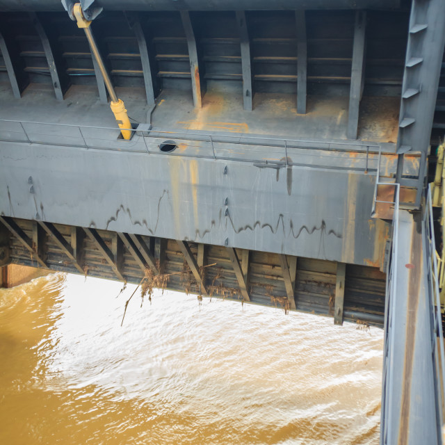 """""""Hydraulic water gate is shifting up to allow water flow through in the rainy..."""" stock image"""