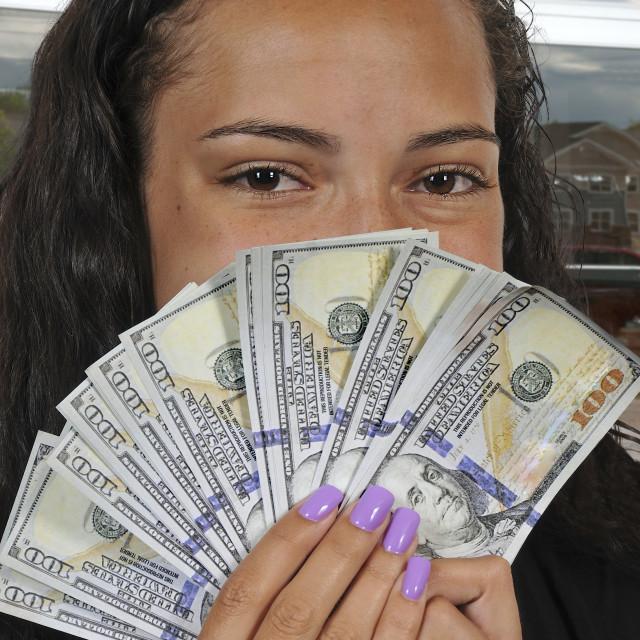 """Black woman Holding 100 Dollar Bills"" stock image"
