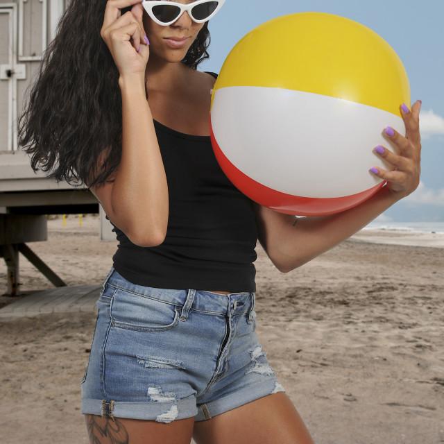 """Woman Holding Beach ball"" stock image"