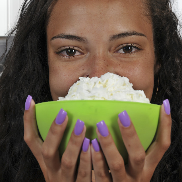 """Woman holding whipped cream"" stock image"
