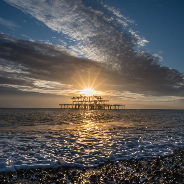 """Starburst over the West Pier"" stock image"