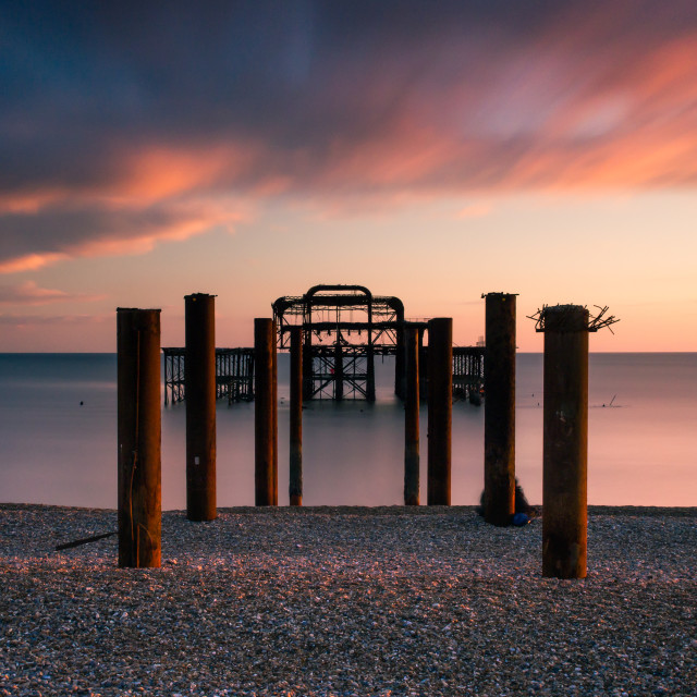 """Behind the West Pier sticks at sunset"" stock image"