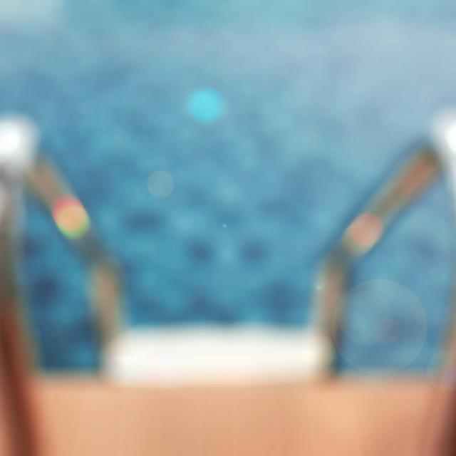 """Blurred of pool railing."" stock image"