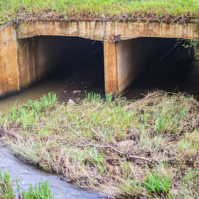 """Reinforced concrete box culverts under the asphalt road. Box culvert is a..."" stock image"