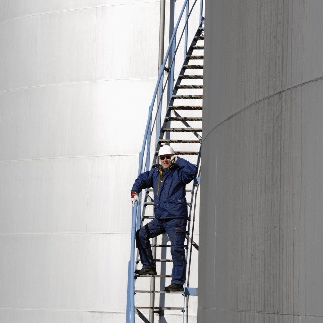 """Oil worker on mobile phone"" stock image"