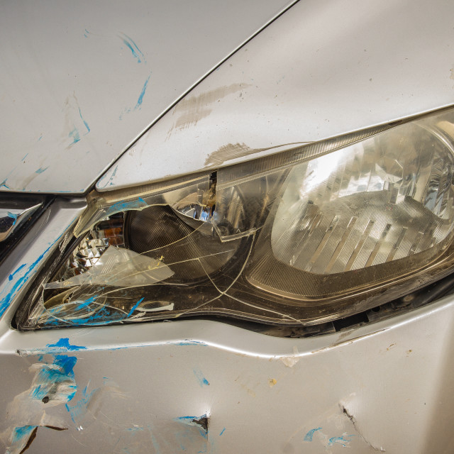 """Close-up front of new silver car distorted by accident. Crashed new silver..."" stock image"
