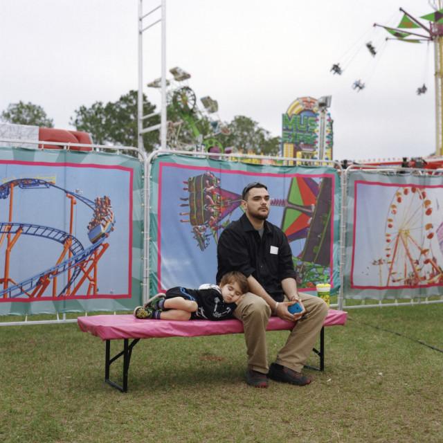 """Child sleeping at fair"" stock image"