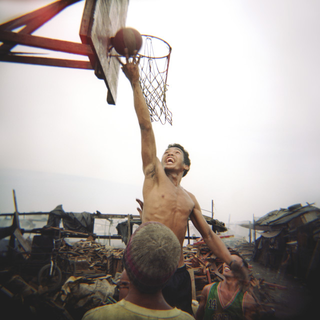"""Man playing basketball"" stock image"