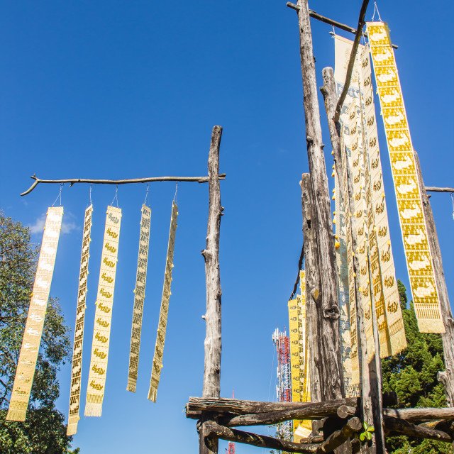 """""""Beautiful traditional northern Thai tribe flags are hanging on the poles with..."""" stock image"""