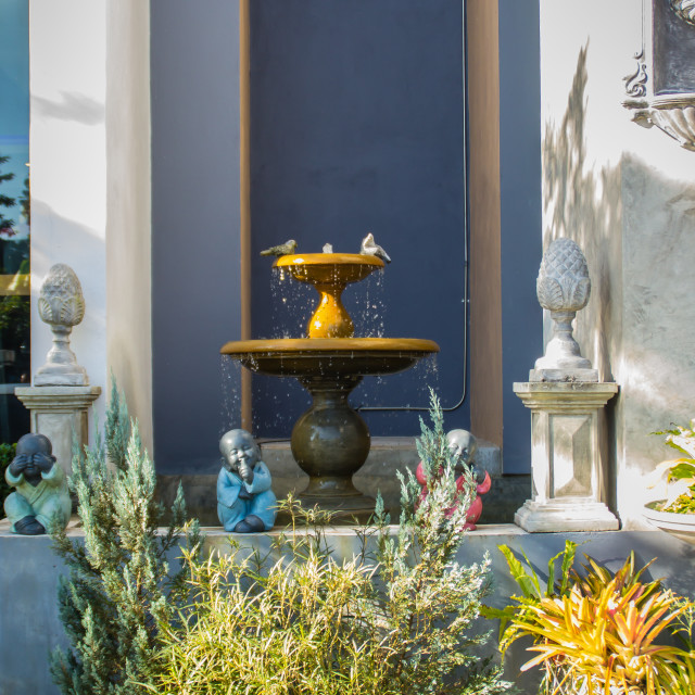 """""""Little fountain in the garden with ornamental plant and dolls"""" stock image"""