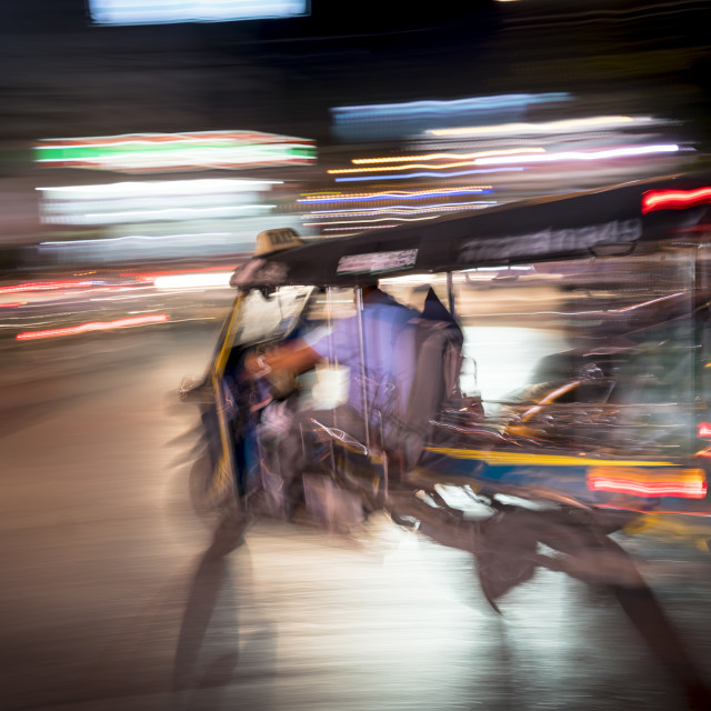 """Tuk-tuk and blurred light"" stock image"