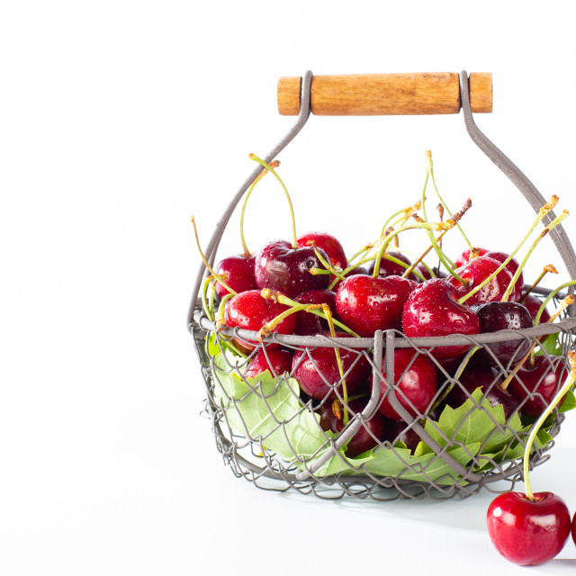"""""""Cherries in a basket"""" stock image"""