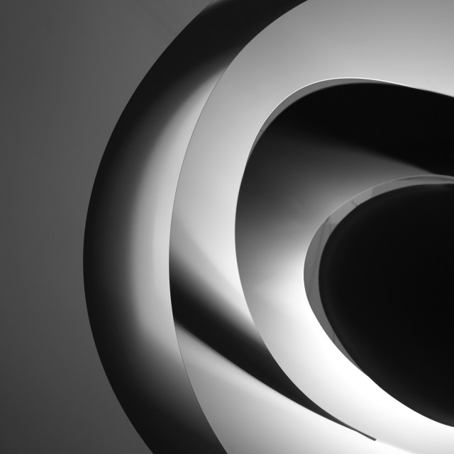 """Abstract architectural ceiling, curves and round lines illuminated by discrete lamps"" stock image"
