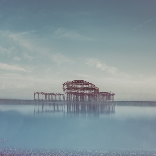 """Reflecting on Brighton West Pier"" stock image"
