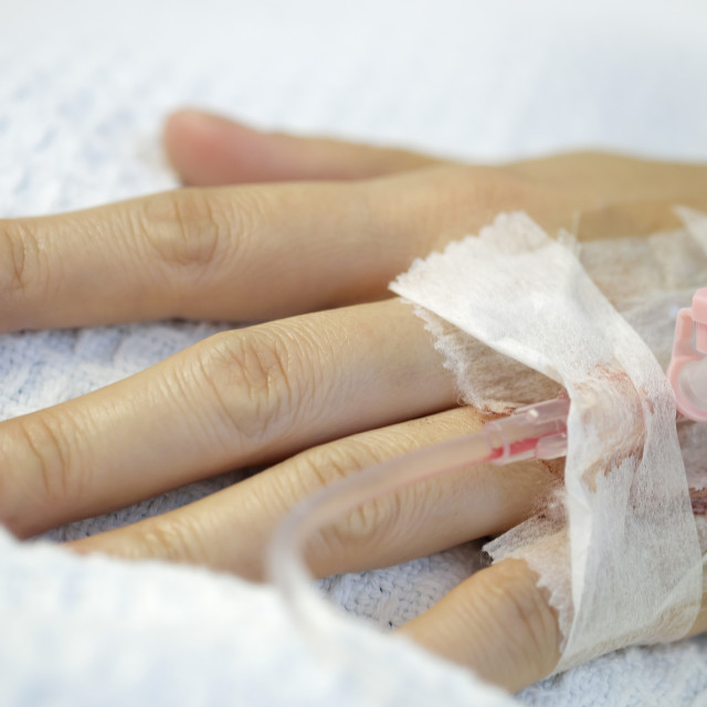 """Close-up of hand inserted with intravenous drip"" stock image"