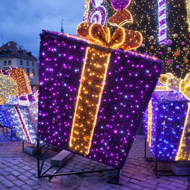 """Christmas Presents Illuminated at Night"" stock image"