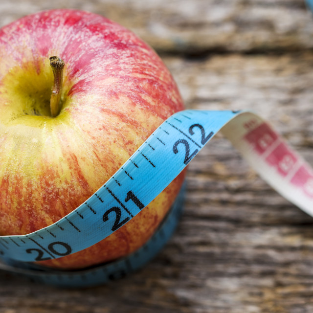 """Red apple with measuring tape"" stock image"