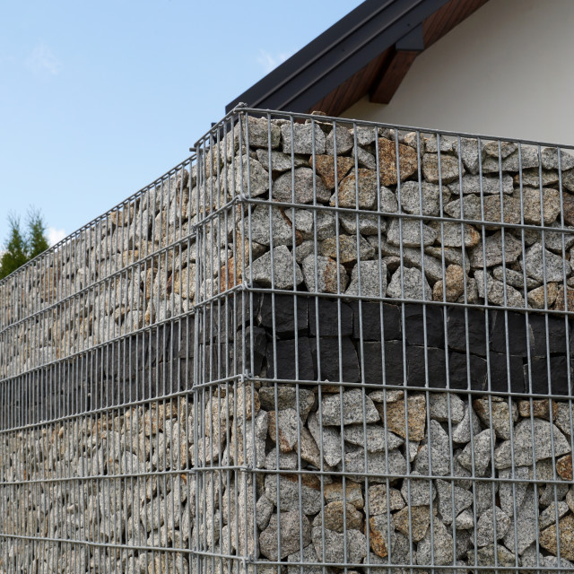 """A fragment of a fence made of a gabion"" stock image"