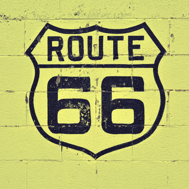 """""""Old Route 66 sign on wall."""" stock image"""