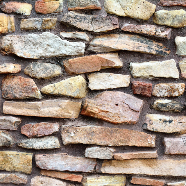 """""""Ancient stone wall to use as background."""" stock image"""