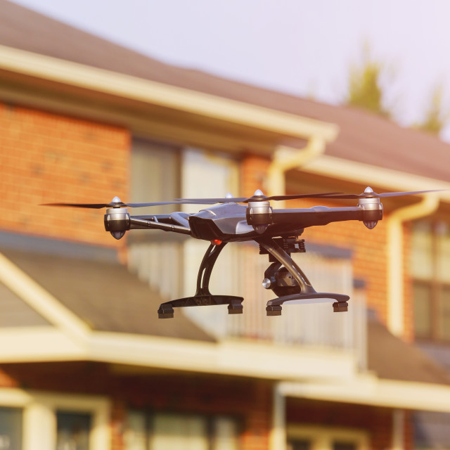 """drone with professional cinema camera flying over a park in fall colors under..."" stock image"