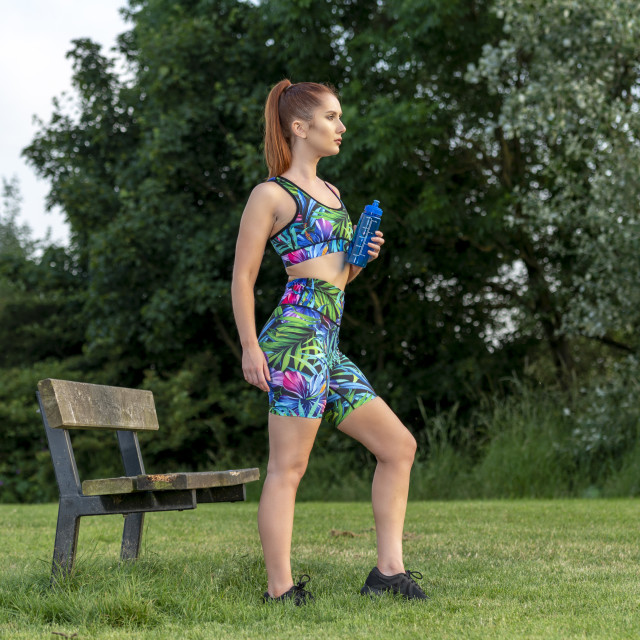 """""""woman wearing sportswear holding a water bottle for refreshment during exercise"""" stock image"""