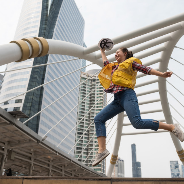 """American female engineer jump in city"" stock image"