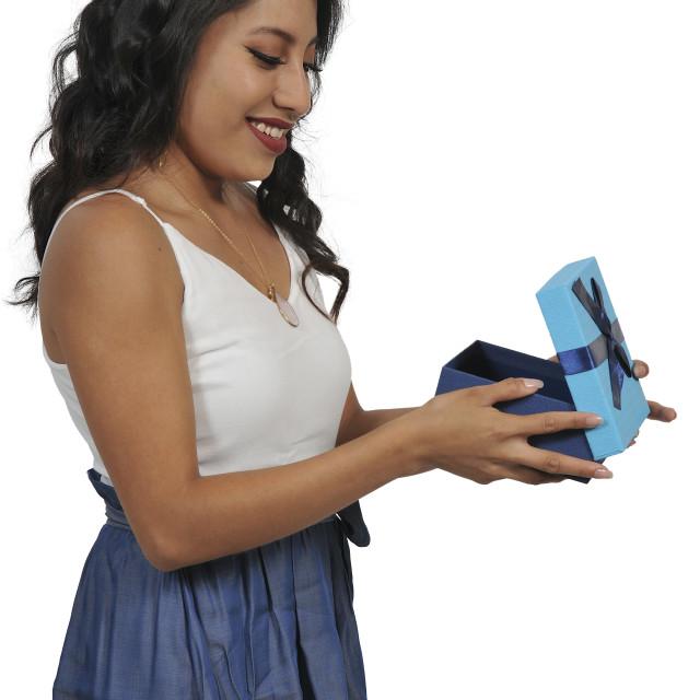 """Beautiful woman opening a present"" stock image"