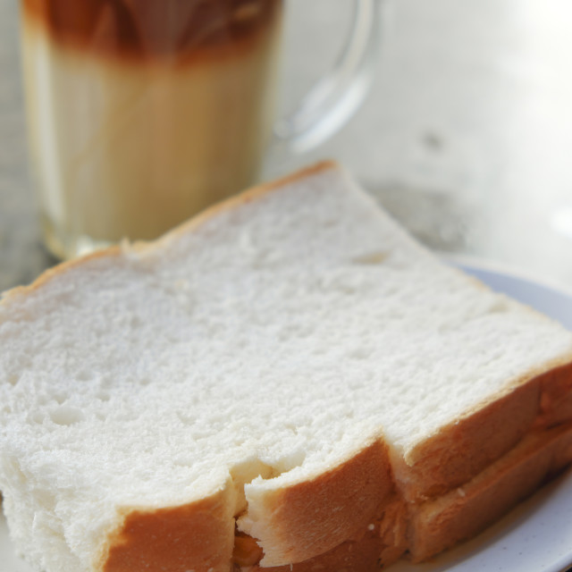 """White bread and hot milk tea"" stock image"