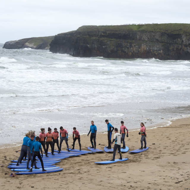 """""""youth being taught surfing at ballybunion beach"""" stock image"""