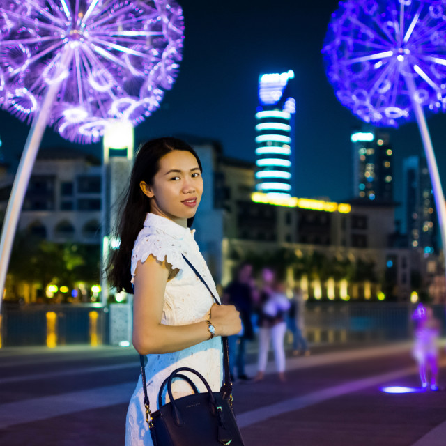 """Girl in downtown Dubai at night"" stock image"