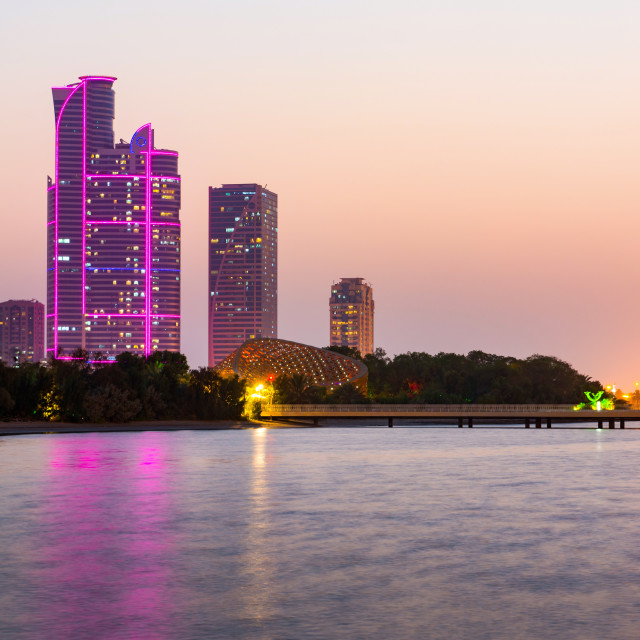 """Sharjah butterfly island and hight buildings at dusk"" stock image"