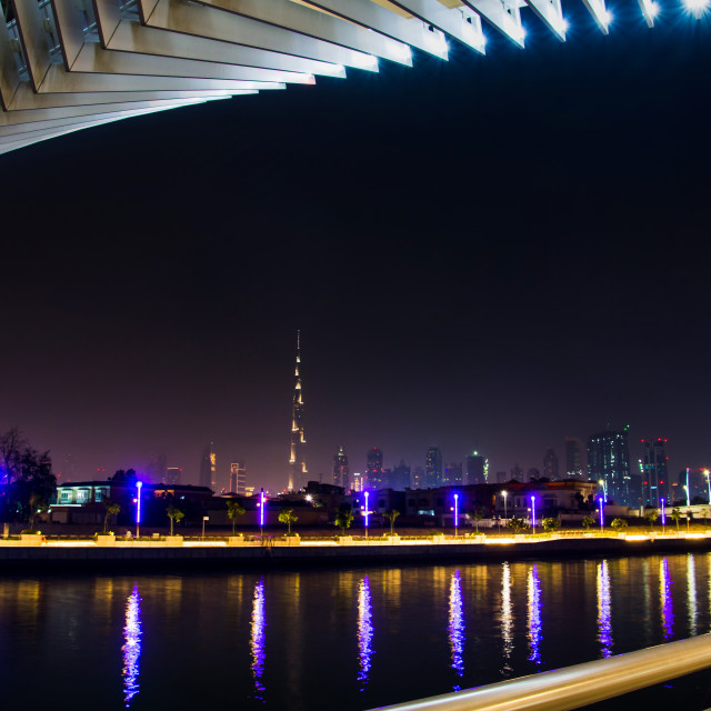 """Dubai Water canal footbridge with city panorama in the backgroun"" stock image"
