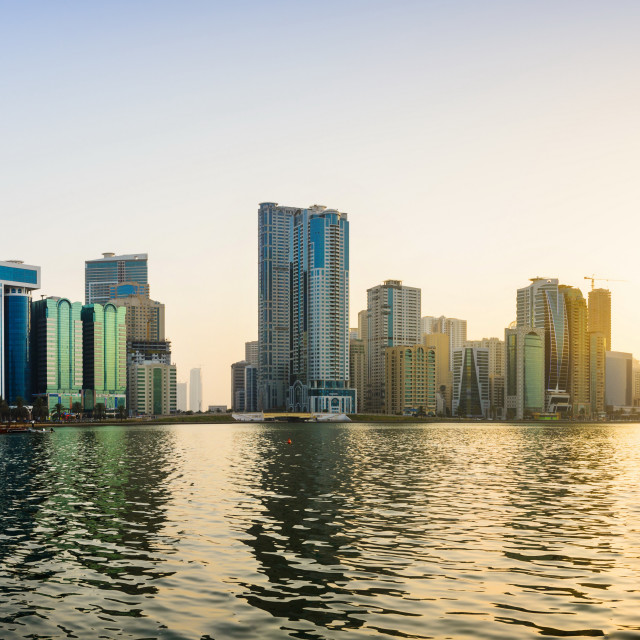 """Panoramic view of Sharjah waterfront in UAE at sunset"" stock image"