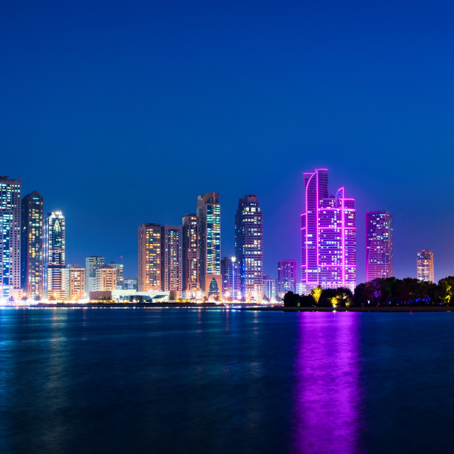 """Sharjah waterfront cityscape in UAE at blue hour"" stock image"