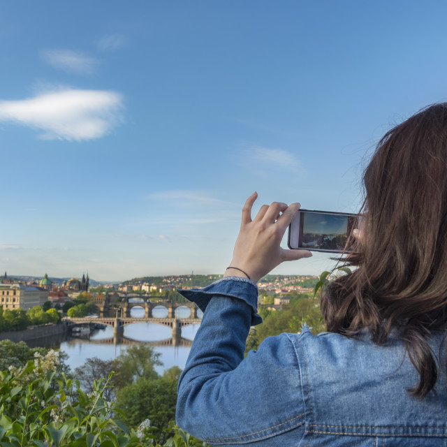 """""""Woman taking photos with phone in Prague"""" stock image"""