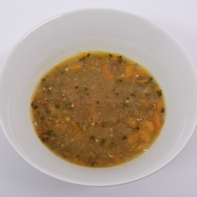 """Lentil soup with carrot on a white"" stock image"